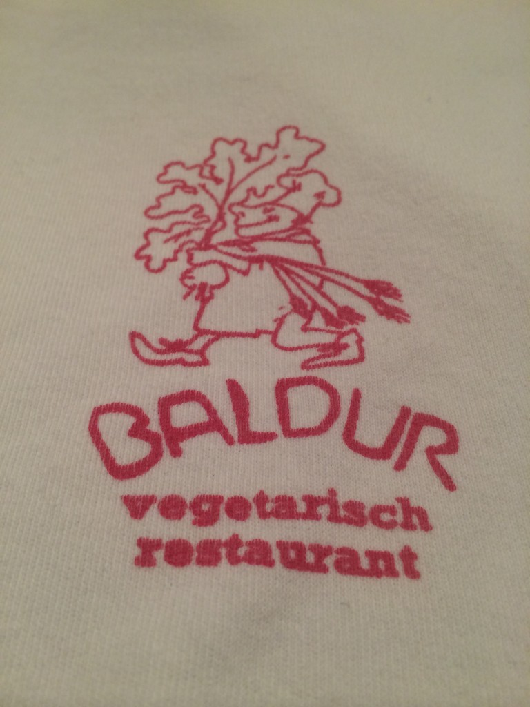 "Each co-worker of the (Bio-Dynamic) vegetarian restaurant  Baldur at the Weteringschans 76 in 1017 XR Amsterdam (next to the Ita Wegman Huis) would wear a white T-shirt with this logo. For a while, these T-shirts were very popular and were acquired daily by customers with a ""happy tommy."""