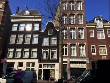 HUK was located at Spuistraat 96 in Amsterdam; the building with the bicycle against the large garage door